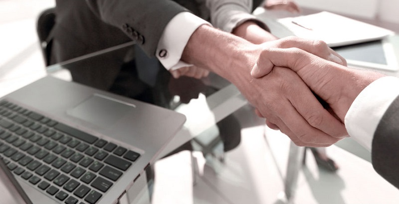Client and Personal Injury Attorney Shaking Hands