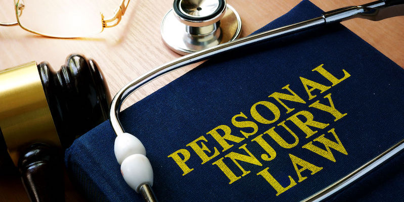 Personal Injury Law concept. Book and stethoscope.
